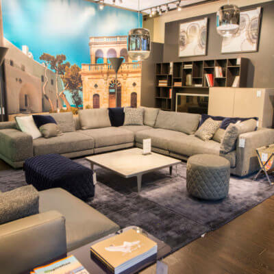 Grey wrap-around sectional couch with loveseat & grey square coffee table